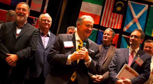 John P. Kelly (with microphone) and other ICAL figures at an event