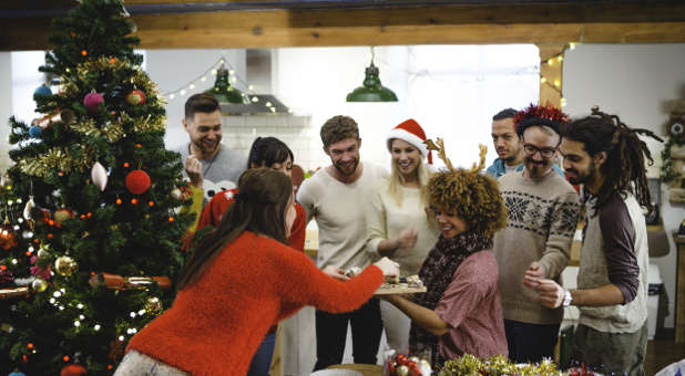 An open-house Christmas party is a good way to break the ice with your neighbors.